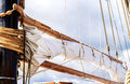 Mast, sails and shroud of a tall ship. Rigging detail. Royalty Free Stock Photo