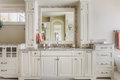 Master bathroom cabinets sink and vanity elegant cabinetry fine craftsmanship lend an upscale touch to a full Royalty Free Stock Photography