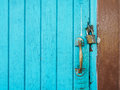Master key and handle lack blue door with copy space Royalty Free Stock Photo