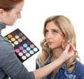 Master of style makes make-up. Stock Images