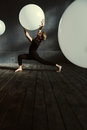 Masterful dancer performing in the dark lighted room