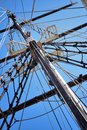 Masting of big wooden sailing ship, detailed rigging without sails Royalty Free Stock Photo