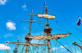 Masts of the frigate against blue sky Stock Photo