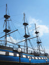 Masts and rigging of a old sailing ship over blue sky background Stock Images