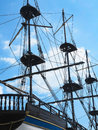 Masts and rigging of a old sailing ship over blue sky background Royalty Free Stock Photo