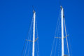 Masts of Sailboats Against a Blue Sky Royalty Free Stock Photo
