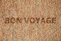 Mat wooden texture background bon voyage text Stock Photography