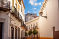 Matador painting narrow streets of seville spain city view street lamp balconies yellow white cityscape andalusia on october Stock Photos