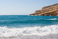 Matala beach crete greece bay with cliff in Royalty Free Stock Images
