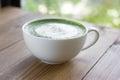Matcha green tea latte beverage in glass. Royalty Free Stock Photo