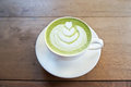 Matcha green tea latte on wood table Royalty Free Stock Images