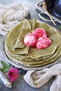 Matcha green tea pancakes and three balls of fruit ice cream Royalty Free Stock Photo
