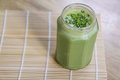 Matcha Green Tea Smoothie in glass jar on table Royalty Free Stock Photo
