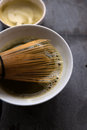 Matcha tea with bamboo whisk close up of the bowl of fresh Stock Photo