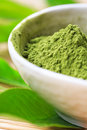 Matcha tea powder in bowl closeup Stock Photo