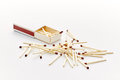 Matchbox and some matches over a white backdrop Royalty Free Stock Images