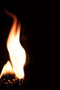 Matches and a big flame of fire, black background and copyspace Royalty Free Stock Photo