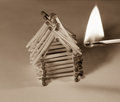 Matches house and match with burning fire - risk of accident Royalty Free Stock Photo