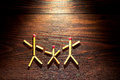 Matches on the wood background, happy family concept Royalty Free Stock Photo