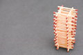 Matchstick tower on a grey background for your concepts about matches construction stability and towers selective focus is on a Stock Images