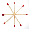 Matchsticks with red heads grouped in a star isolated on white Stock Photo