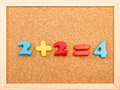 Math addition simple mathematic on a wooden frame cork board Stock Photos