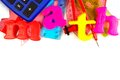 Math magnetic letters with school supplies toy spelling a themed top border over white Royalty Free Stock Images