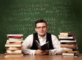 Math teacher at desk Royalty Free Stock Photo