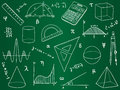 Mathematics icons on school board Royalty Free Stock Photos