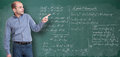 Maths teacher friendly by the blackboard Stock Images