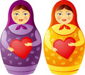 Matryoshka doll holding a heart Royalty Free Stock Image
