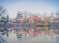 Matsumoto castle is one of the most complete and beautiful among japan s original castles reflection vintage Royalty Free Stock Image