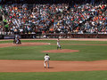 Matt Cain throws pitch as 2nd base Freddy Sanchez Stock Images