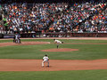 Matt Cain throws pitch as 2nd base Freddy Sanchez Royalty Free Stock Photos