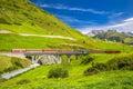 The Matterhorn - Gotthard - Bahn train on the viaduct bridge near Andermatt in Swiss Alps Royalty Free Stock Photo