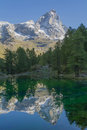 The matterhorn reflected in waters of blue lake in valtournenche Royalty Free Stock Images