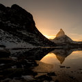 Matterhorn from Riffelsee mountain lake above Zermatt Stock Photo