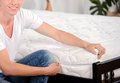 Mattress demonstration of quality a young man holding demonstrations quality in the bedroom Royalty Free Stock Photos