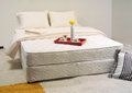 Mattress with sheets and pillows Stock Photography