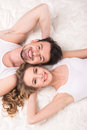 Mattress top view of young beautiful couple are lying on the quality Royalty Free Stock Photography