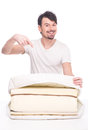 Mattress young man with a nice made of coconut fiber is looking at the camera and smiling Royalty Free Stock Photo