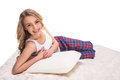 Mattress young smiling woman is lying on the quality and looking at the camra over white background Royalty Free Stock Image