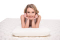 Mattress young smiling woman is lying on the quality and pillow over white background Stock Photo