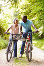 Mature african american couple on cycle ride in countryside happy smiling at each other Royalty Free Stock Photos
