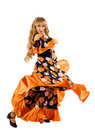 Mature blond woman dance in gypsy costume Stock Photos