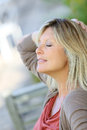 Mature blond woman relaxing outdoors Royalty Free Stock Photo