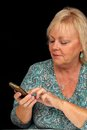 Mature Blonde Woman with Cell Phone (2) Royalty Free Stock Photography