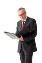 Mature business man with folder, reading Royalty Free Stock Photo