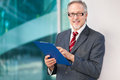 Mature business man holding some documents outdoor Royalty Free Stock Photo