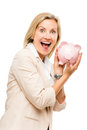 Mature business woman holding piggy bank isolated on white backg smiling Stock Image